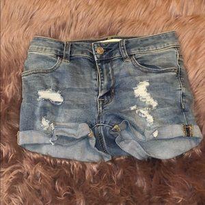 Ripped mid wash denim jean shorts.